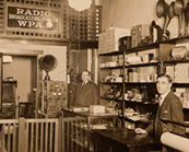 F.M. Doolittle and Italo Martino in WPAJ Storefront circa 1923