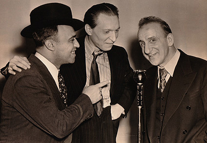 November 17, 1939 - unknown man and WDRC's Ray Barrett talk with CBS comedian Jimmy Durante