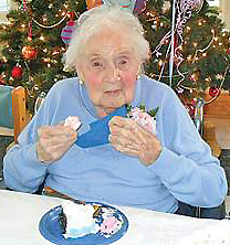 Peggy (Reichel) Haase enjoys a piece of cake on her 105th birthday in 2012!