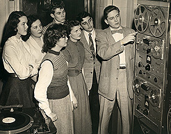 WDRC production manager Charlie Parker explains the finer points of tape recording to a group of high school students, circa 1950